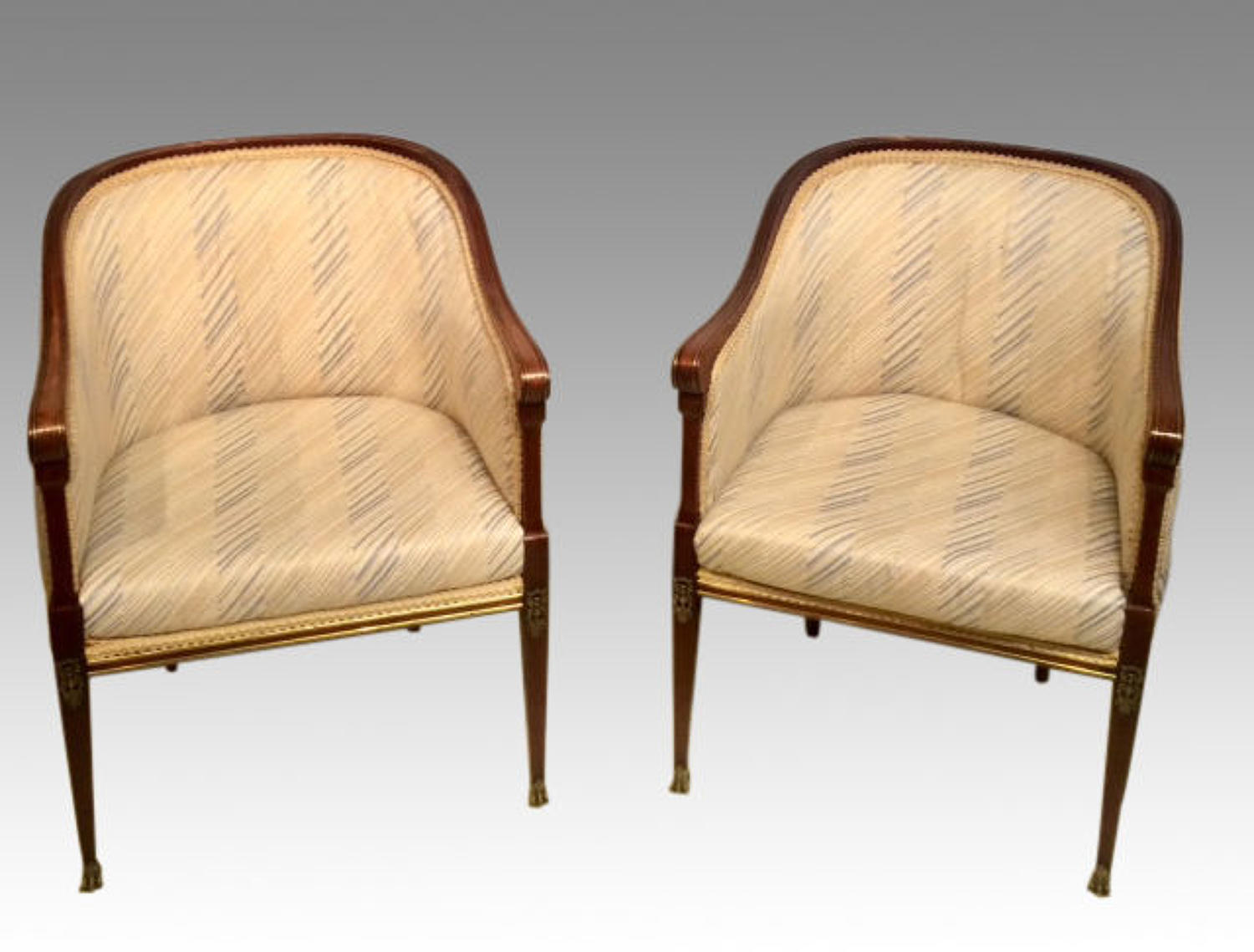 Pair of French empire mahogany armchairs.