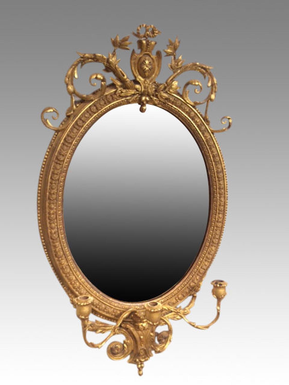Antique oval gilt mirror.