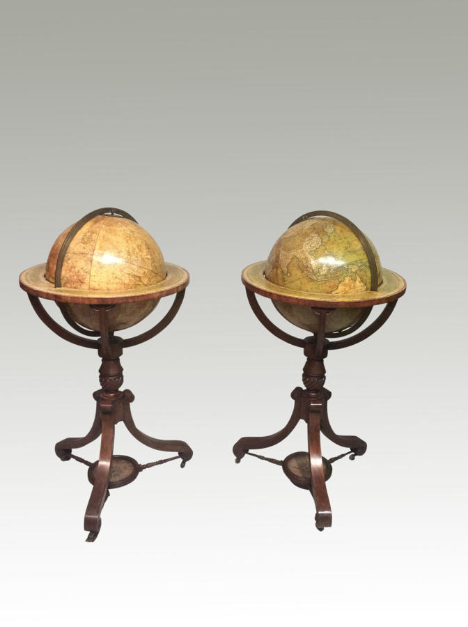 A pair of antique Georgian globes by Newton.