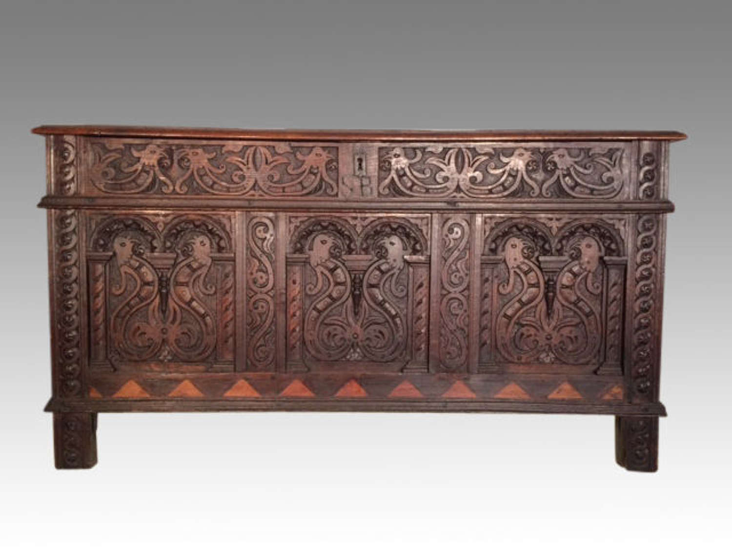 17th century antique carved oak arcaded front coffer.
