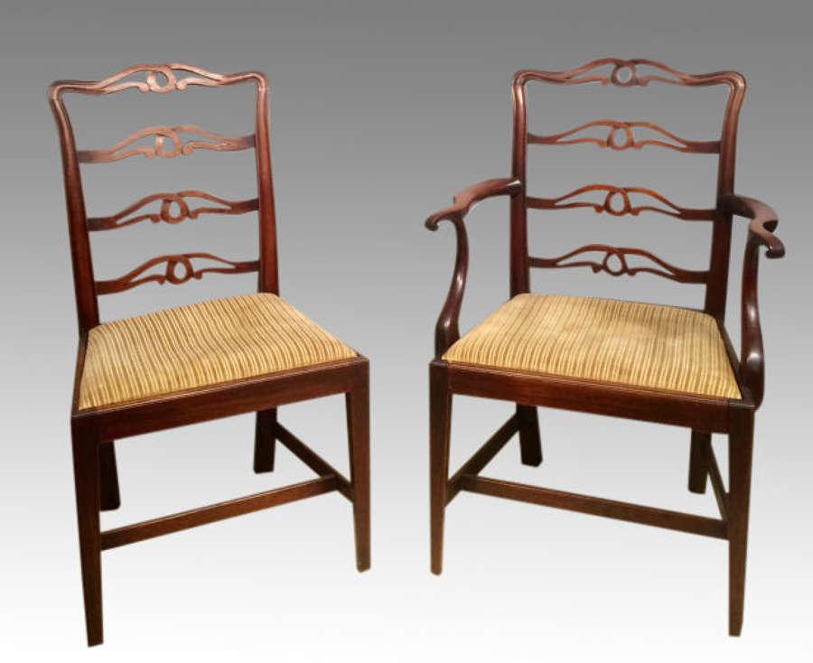 Set of 7 Geo III mahogany dining chairs.