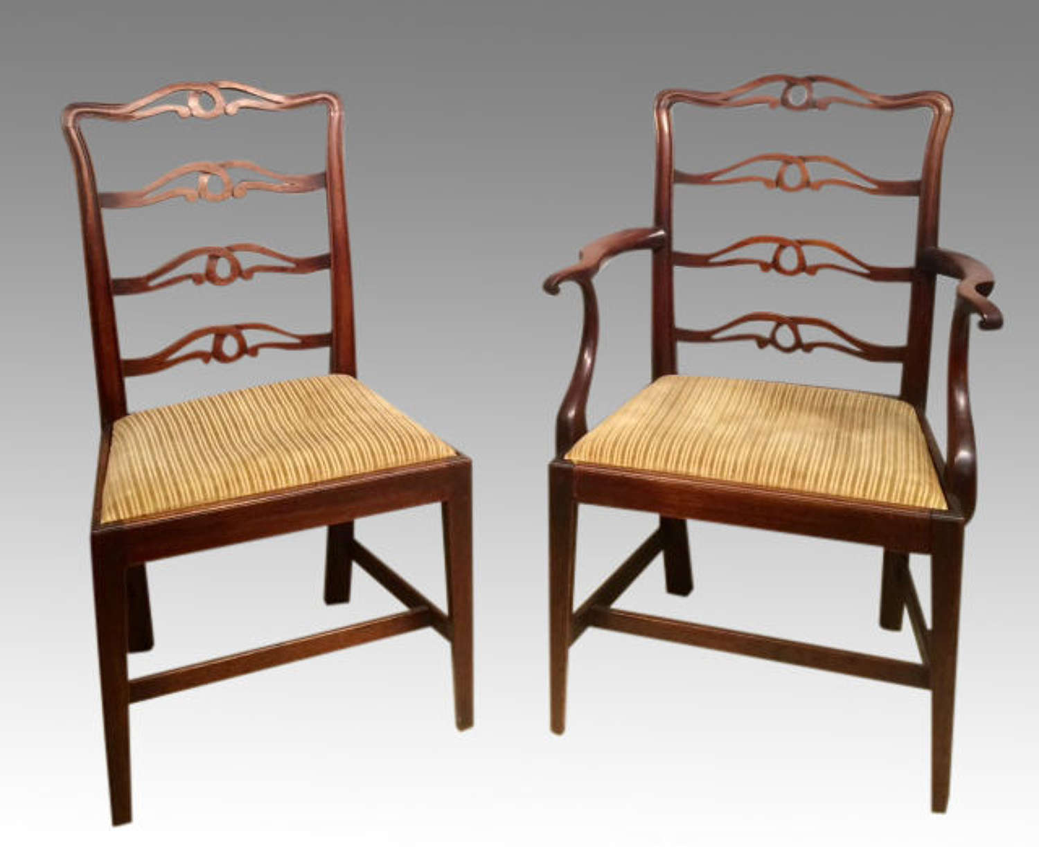 Set of 7 Geo III mahogany dining chairs.