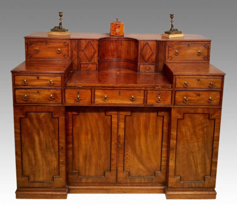 An antique Regency mahogany writing desk.