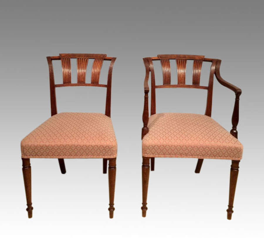 A set of 16 antique Georgian mahogany dining chairs.