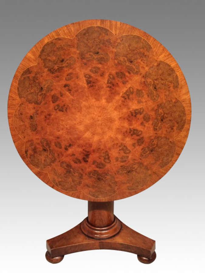 A 19th century antique circular mahogany centre table.