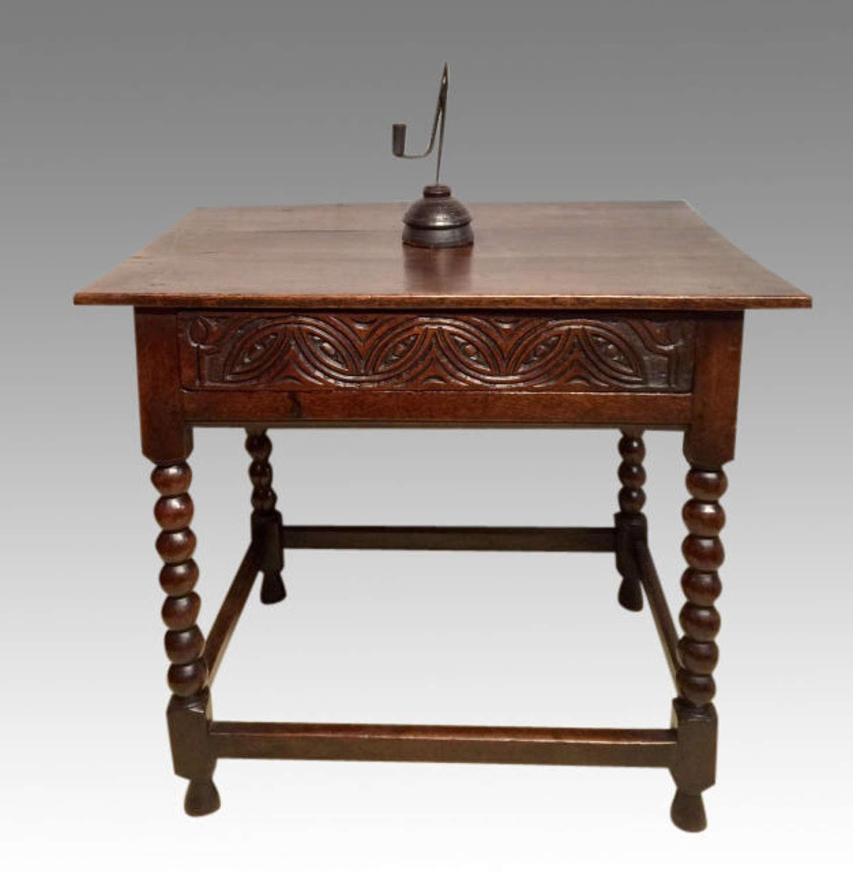 A Charles II antique oak side table.