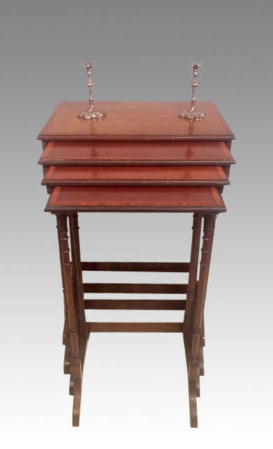 An nest of four antique mahogany tables.