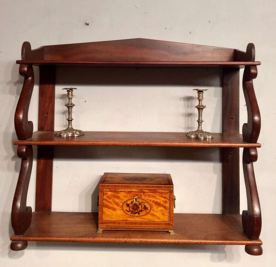 Set of antique Regency mahogany hanging shelves.