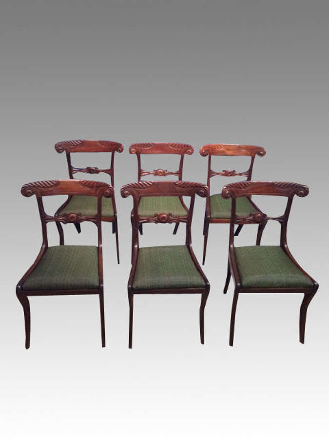 A set of 6 antique Regency mahogany dining chairs.