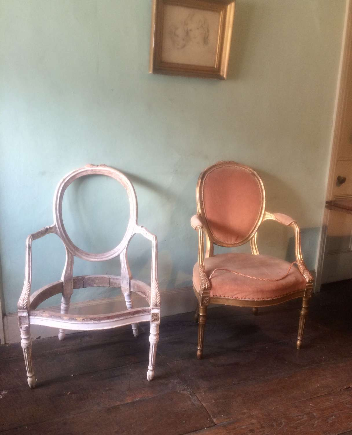 Pair of 18th century antique carved giltwood armchairs