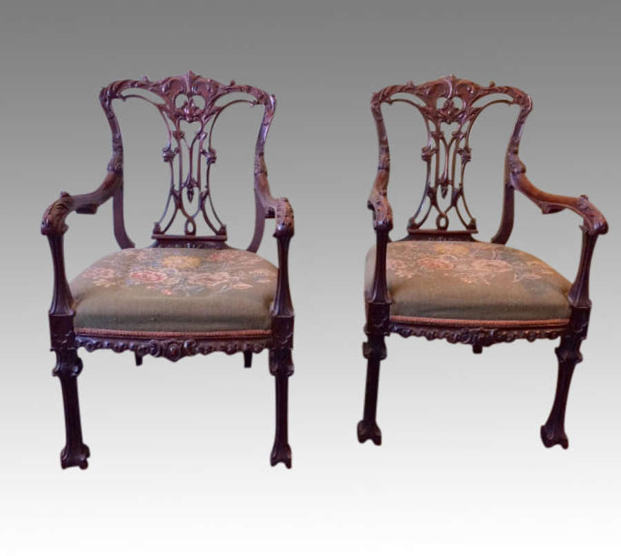 A pair of  carved Chippendale Revival mahogany armchairs.
