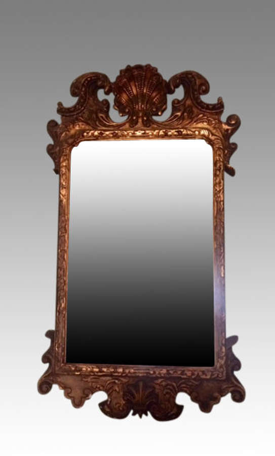 A Geo II style antique carved giltwood mirror.