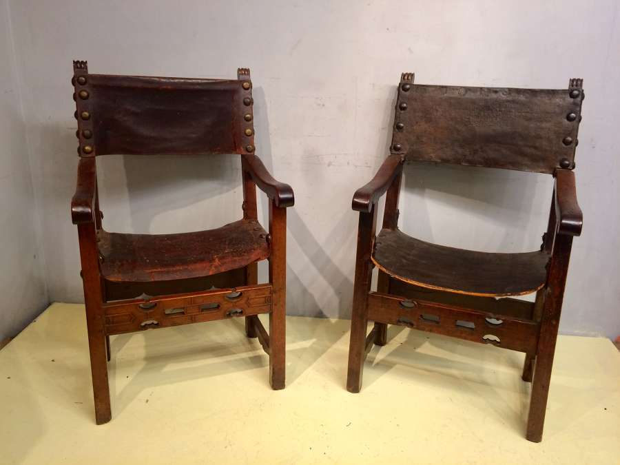 A near pair of  18th century Spanish walnut armchairs.
