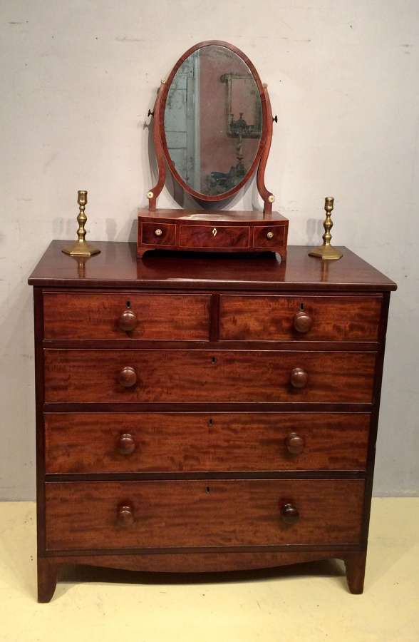 A late Georgian mahogany chest of five drawers.