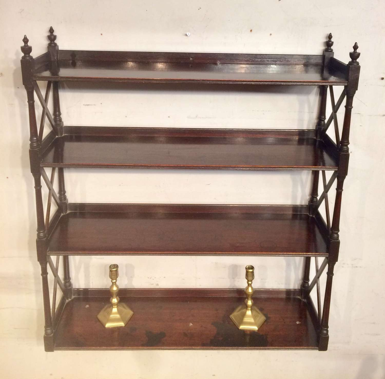 Set of Regency mahogany hanging shelves.