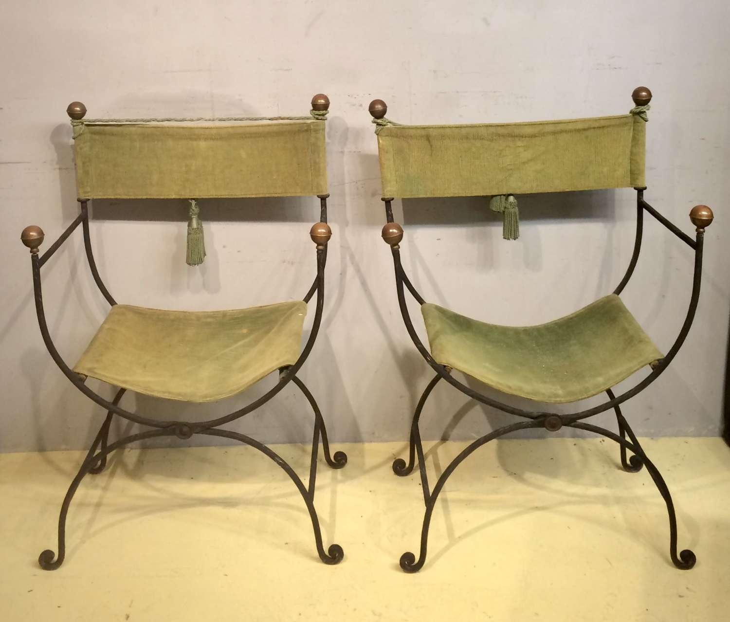 A pair of Spanish decorative iron folding chairs.
