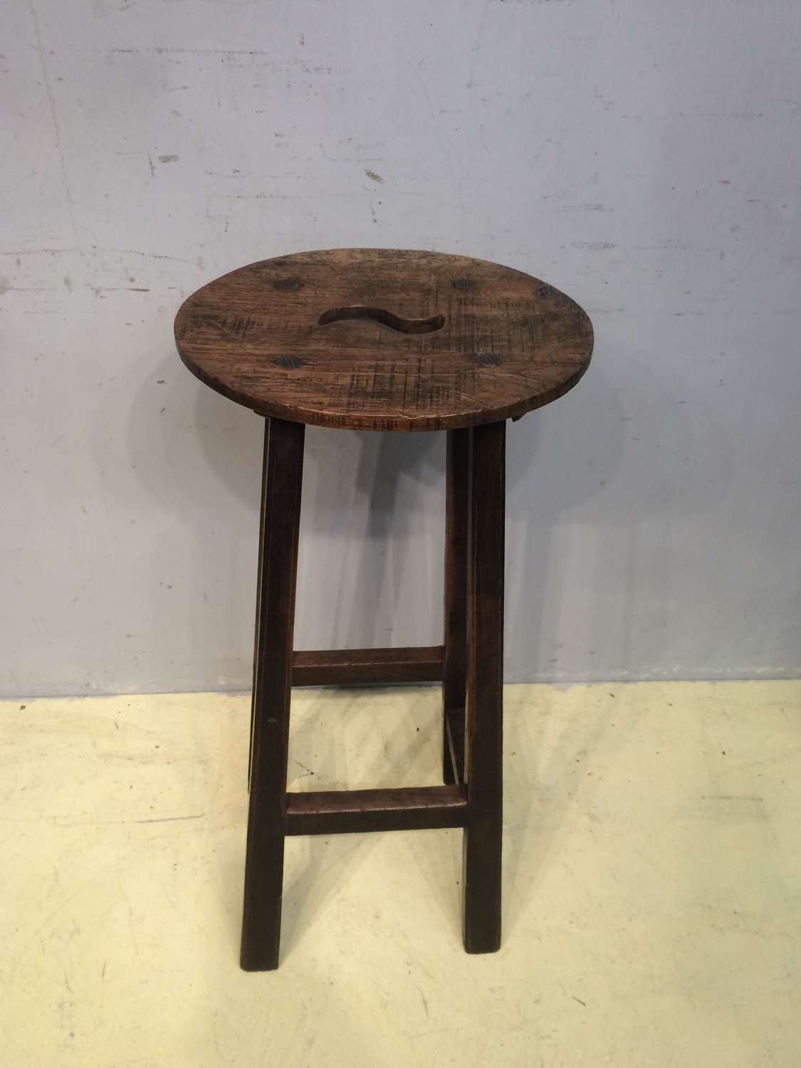 19th century oak tall oval topped stool .