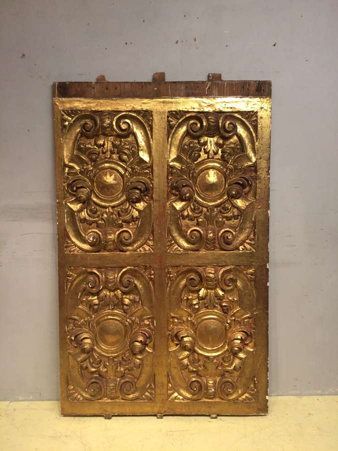 A late 17th century carved giltwood panel.