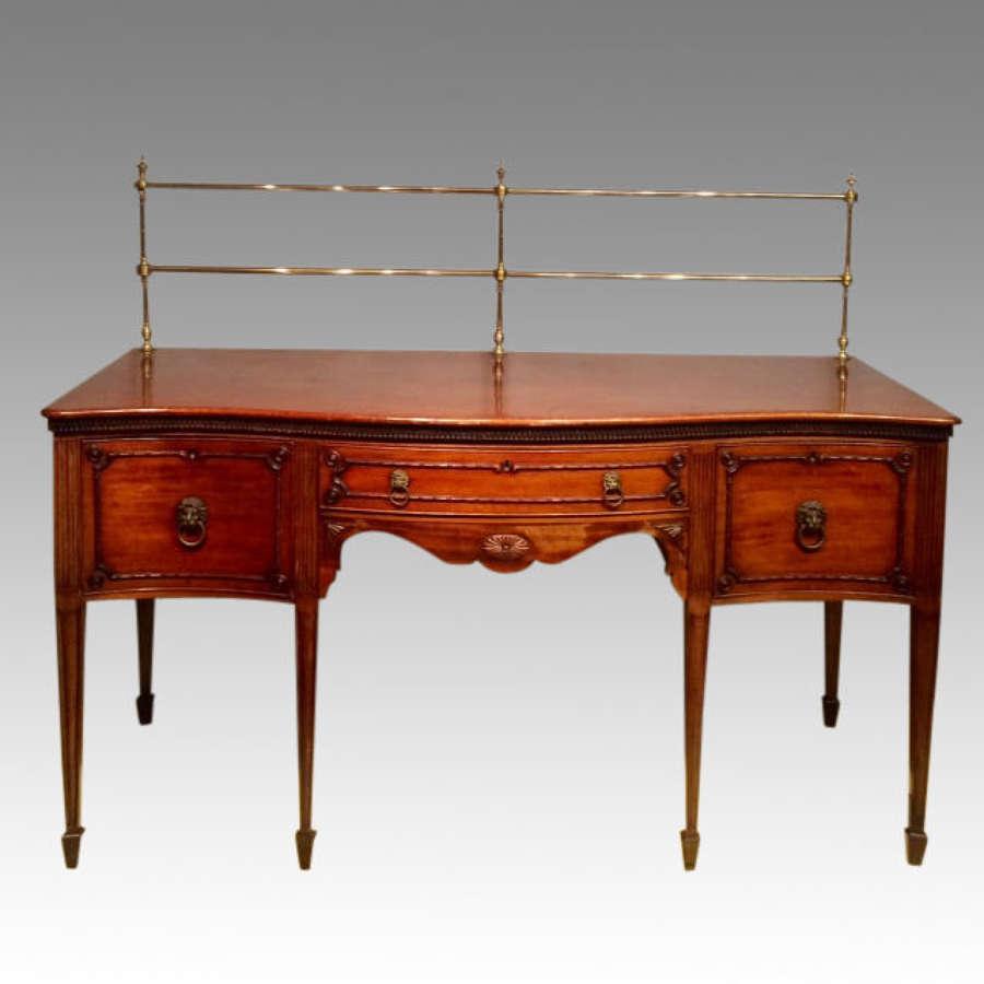 Hepplewhite style serpentine mahogany sideboard.