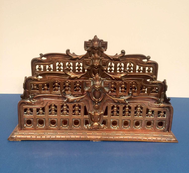 19th century cast metal desk letter rack.