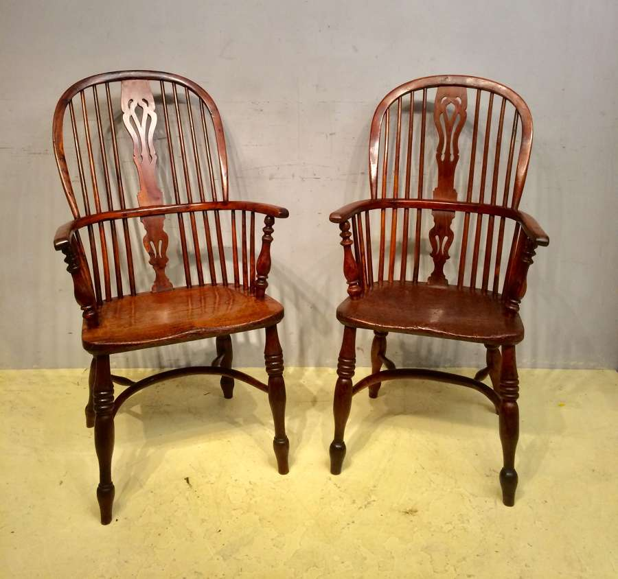 A matched pair of 19th century yew wood Windsor armchairs
