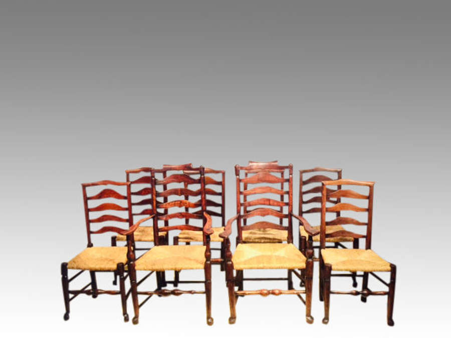 Set of 8 antique Lancashire rush seat dining chairs.