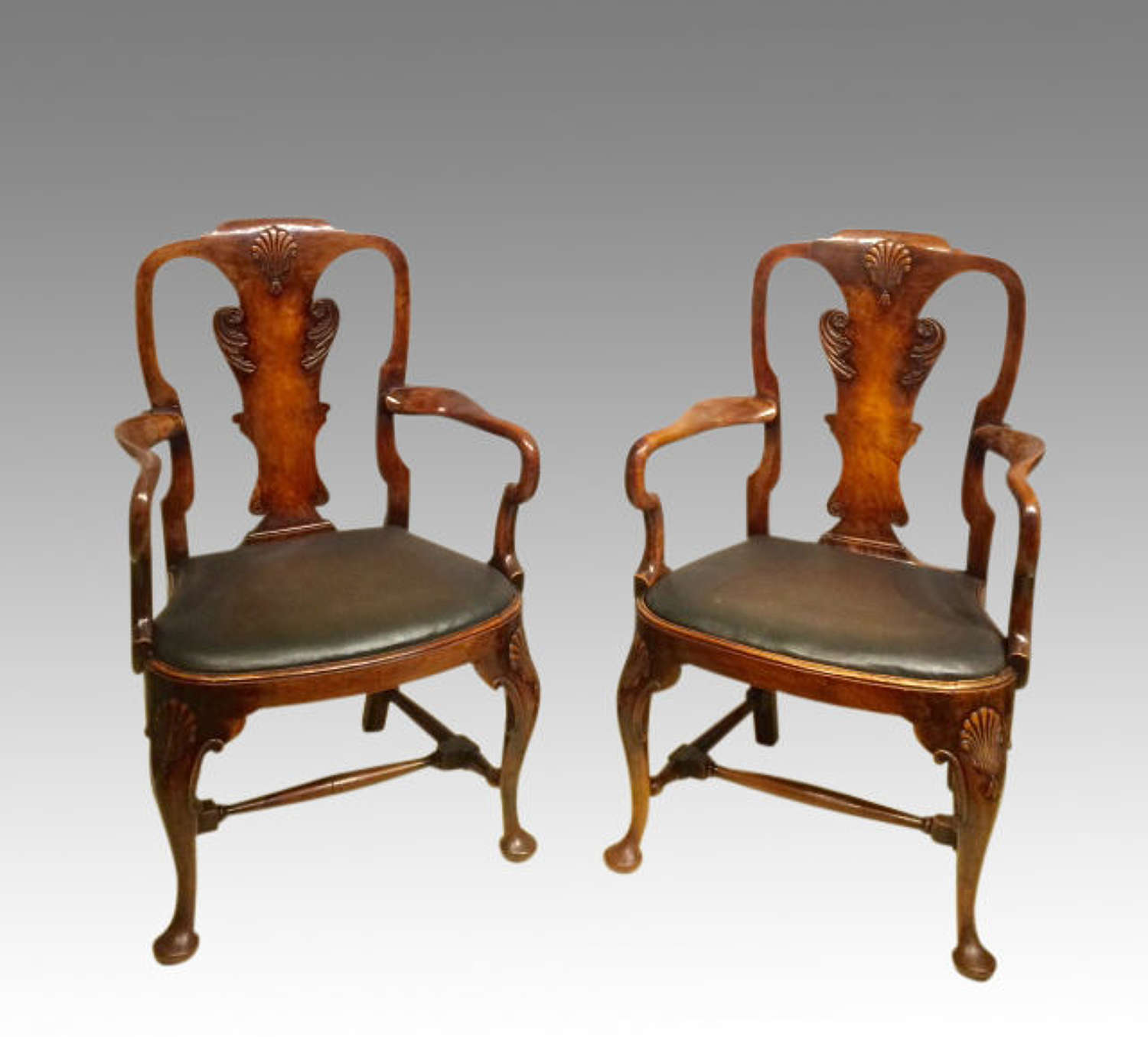 Pair of antique walnut armchairs in the Queen Anne style.