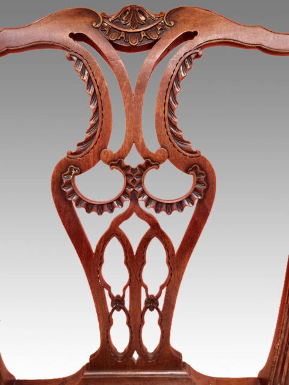 A set of six carved Chippendale mahogany dining chairs