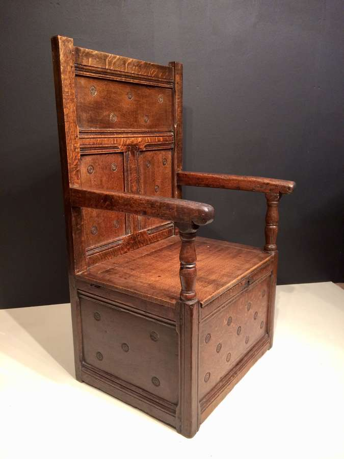 17th century carved oak box seat armchair.