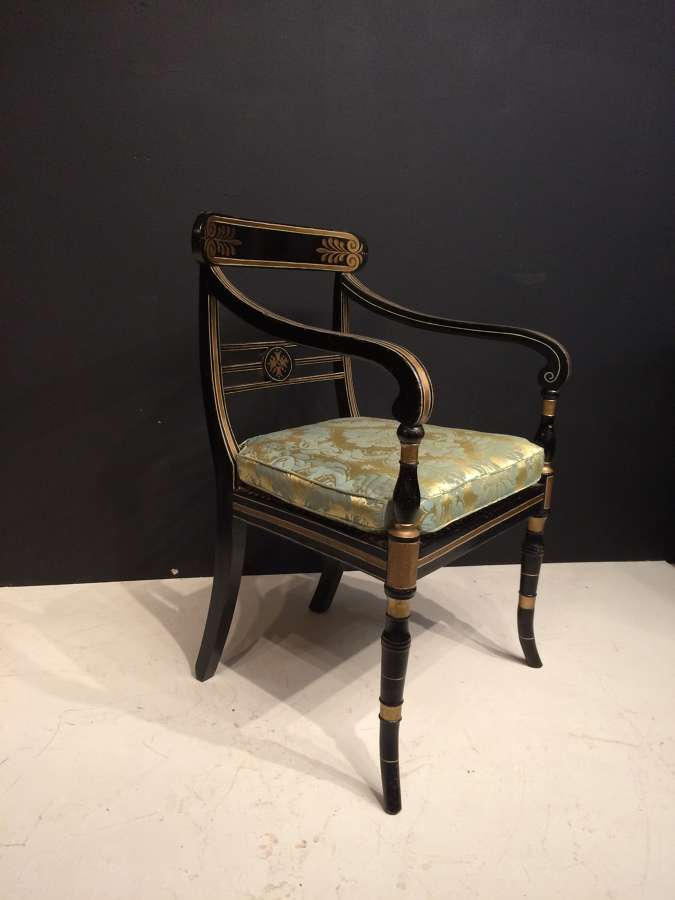 Regency black and gilt painted armchair.