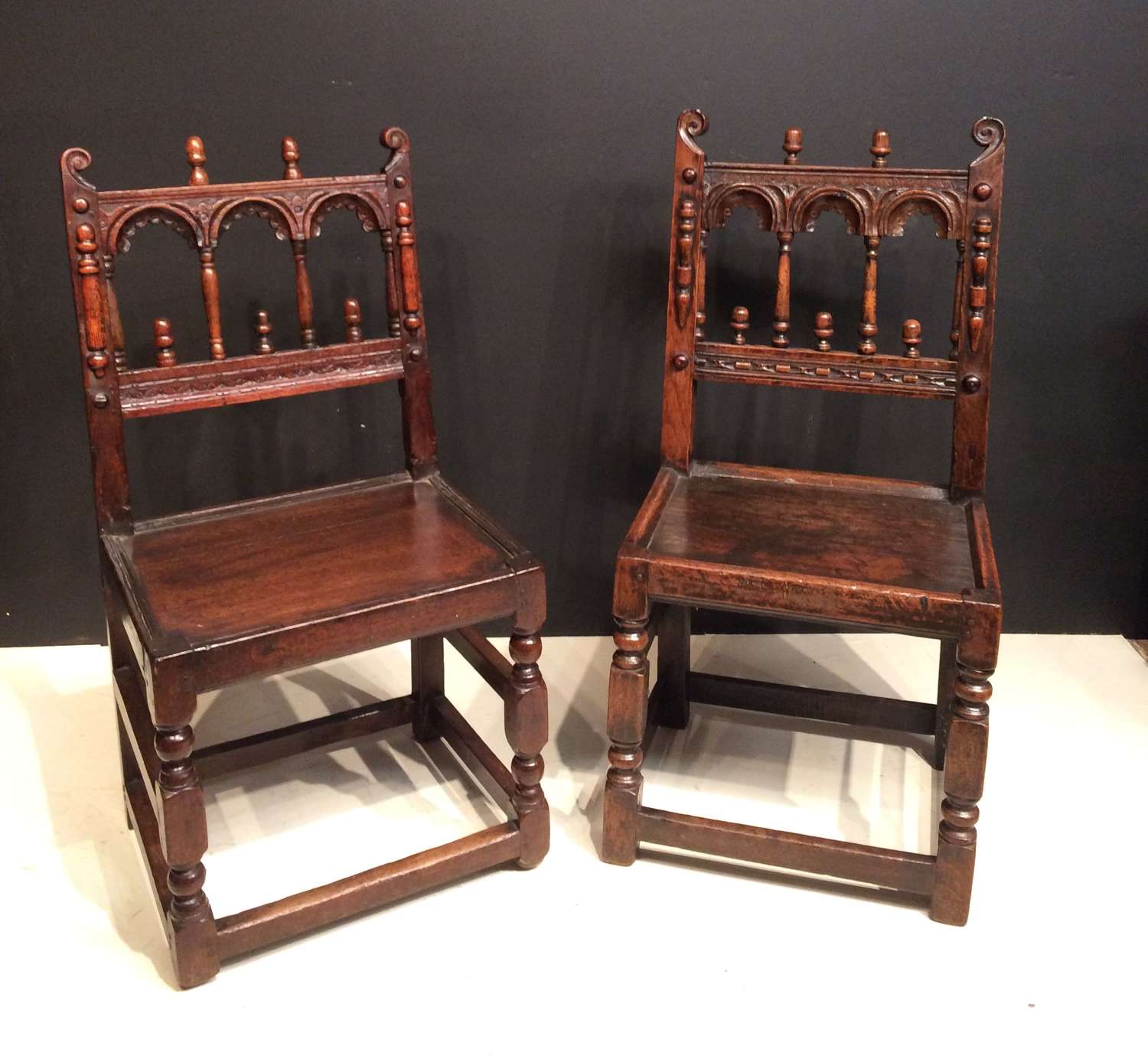 Pair of Charles II oak chairs.
