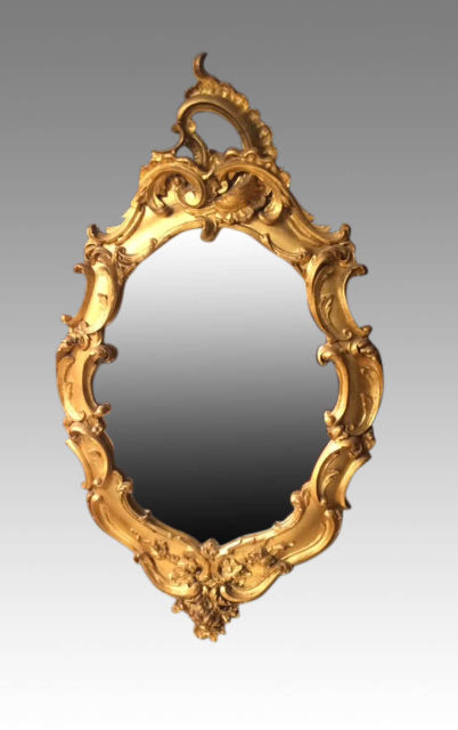 19th century oval carved giltwood mirror.