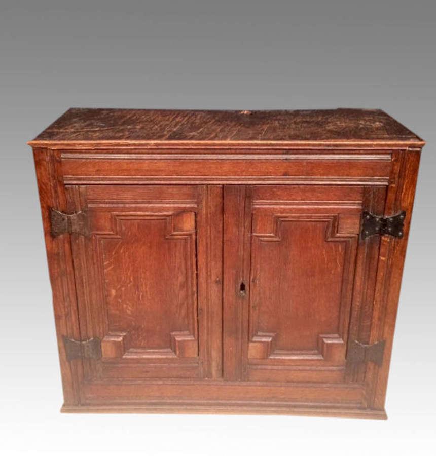 Small 17th century oak cupboard.
