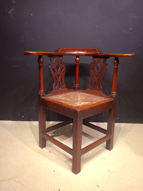 Georgian oak corner chair.