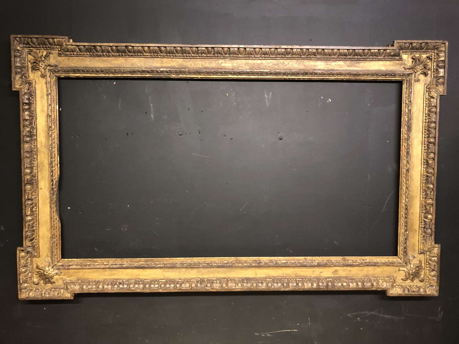 Large 18th century carved giltwood picture frame.