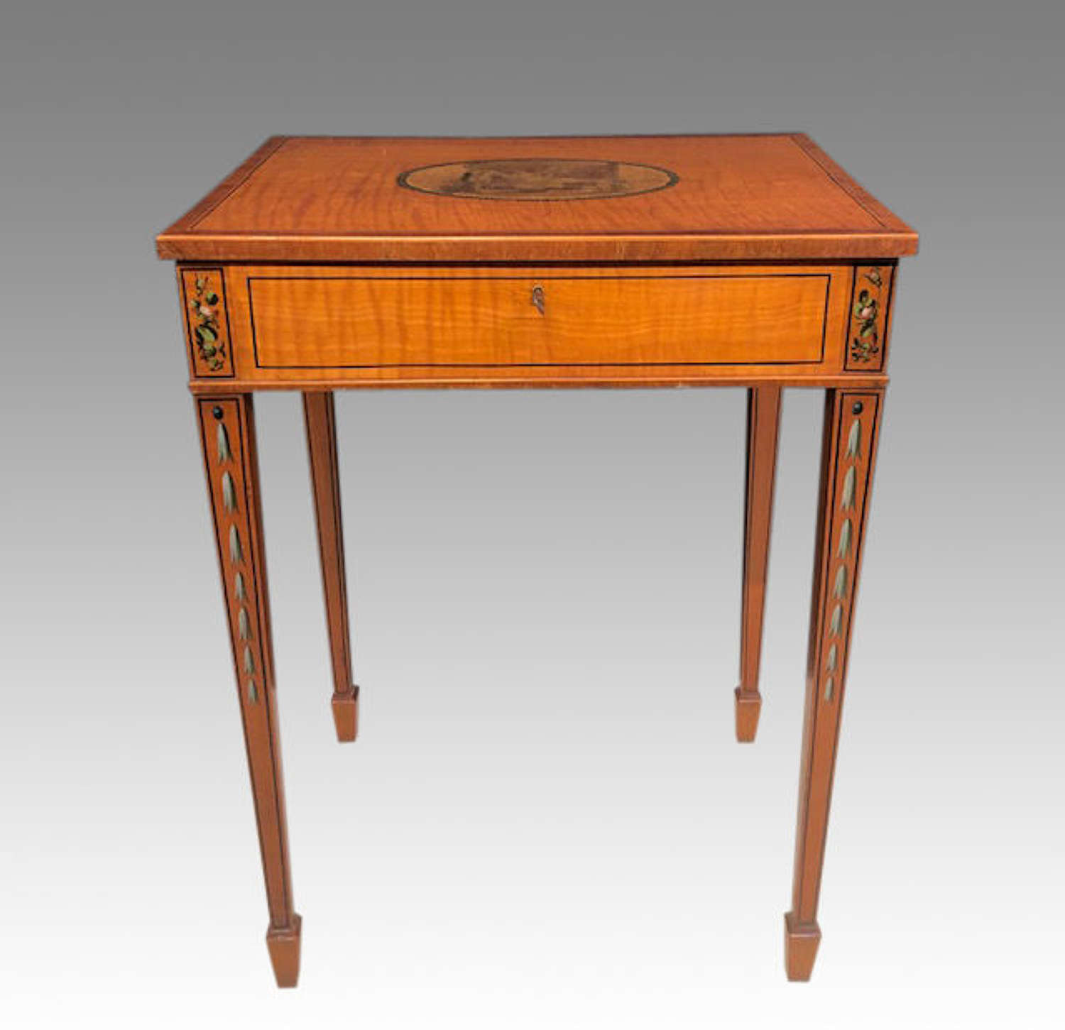 19th century painted satinwood work table.
